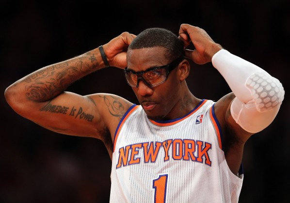 NEW YORK, NY - JANUARY 01: Amar'e Stoudemire #1 of the New York Knicks adjusts his glasses in the first quarter against the Portland Trail Blazers on January 1, 2013 at Madison Square Garden in New York City. NOTE TO USER: User expressly acknowledges and agrees that, by downloading and/or using this photograph, user is consenting to the terms and conditions of the Getty Images License Agreement. (Photo by Elsa/Getty Images)
