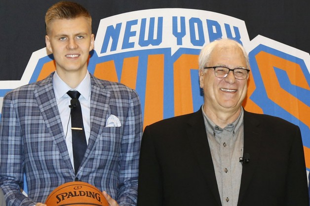 6/26/15 - (l-r); New York Knicks GM Steve Mills, Knicks 1st round pick Kristaps Porzingis, New York Knicks President Phil Jackson, Knicks 1st round pick Jerian Grant, and New York Knicks head coach Derek Fisher, pose for a photo before a press conference introducing the players at the Knicks training facility in Greenburgh, New York this morning.