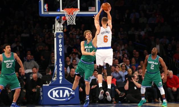 Dec 7, 2015; New York, NY, USA;  New York Knicks forward Kristaps Porzingis (6) shoots over Dallas Mavericks forward Dirk Nowitzki (41) during the first quarter at Madison Square Garden. Mandatory Credit: Anthony Gruppuso-USA TODAY Sports