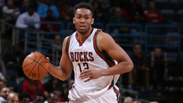 MILWAUKEE, WI - OCTOBER 11: Jabari Parker #12 of the Milwaukee Bucks dribbles the ball against the Chicago Bulls during the game on October 11, 2014 at BMO Harris Bradley Center, Milwaukee, Wisconsin. NOTE TO USER: User expressly acknowledges and agrees that, by downloading and or using this Photograph, user is consenting to the terms and conditions of the Getty Images License Agreement. Mandatory Copyright Notice: Copyright 2014 NBAE (Photo by Gary Dineen/NBAE via Getty Images)