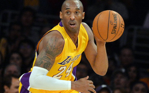 Kobe Bryant of the Los Angeles Lakers drives against the Memphis Grizzlies during their NBA game 33 at the Staples Center in Los Angeles, California on January 2, 2014. The Grizzlies went on to win 109-106. AFP PHOTO/MARK RALSTONMARK RALSTON/AFP/Getty Images