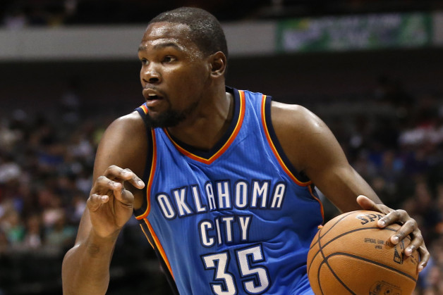 """FILE - In a Friday, Oct. 10, 2014 file photo, Oklahoma City Thunder forward Kevin Durant (35) drives to the basket in front of Dallas Mavericks forward Al-Farouq Aminu (7) during the first half of a preseason NBA basketball game, in Dallas, Texas. Durant has a fractured right foot and the NBA's MVP seems likely to be sidelined for at least the start of the season. The team said Sunday, Oct. 12, 2014 in a statement he was diagnosed with a """"Jones"""" fracture — a broken bone at the base of the small toe. (AP Photo/Jim Cowsert, File)"""