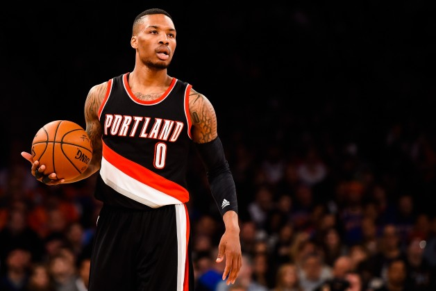 NEW YORK, NY - DECEMBER 07: Damian Lillard #0 of the Portland Trail Blazers looks on during a game against the New York Knicks at Madison Square Garden on December 7, 2014 in New York City. NOTE TO USER: User expressly acknowledges and agrees that, by downloading and/or using this photograph, user is consenting to the terms and conditions of the Getty Images License Agreement. (Photo by Alex Goodlett/Getty Images)
